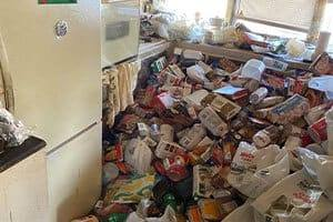 Hoarder Clean Up in Alameda, CA, for junk on a kitchen floor