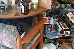 Junk piled up near a table and chair needing Hoarder Clean Up in Folsom, CA