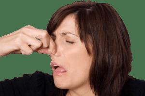 Woman pinching nose due to odor