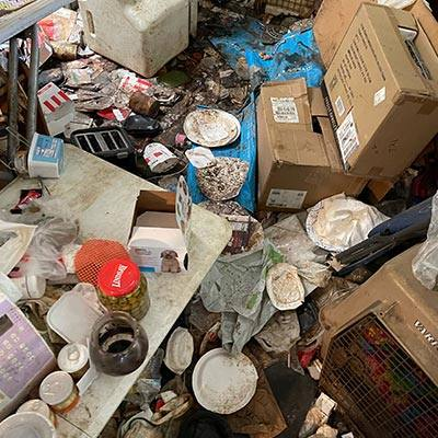 House with Trash on Floor for Hoarder Cleanup in Modesto, CA