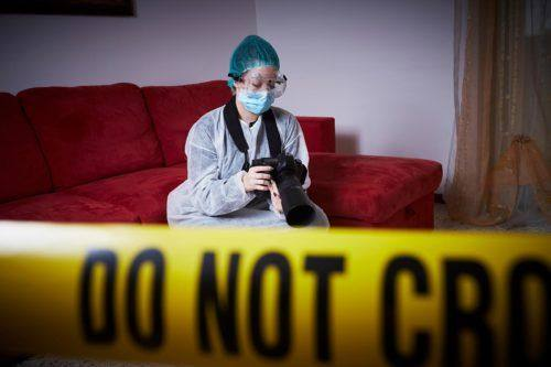 Unattended Death Clean Up in Fresno being photographed by a forensics professional